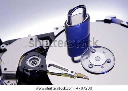 Padlock on computer hard-drive disc - stock photo