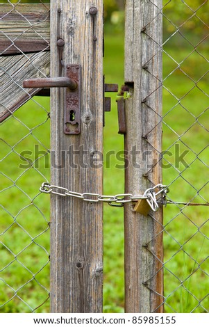 Padlock on fence door