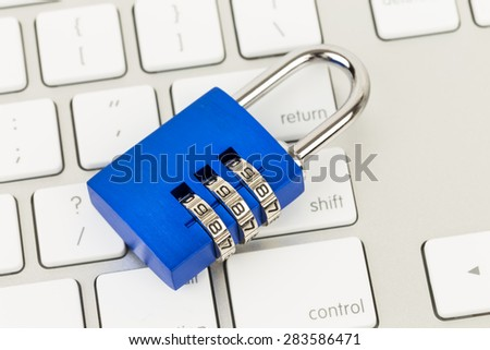 Padlock on keyboard concept computer security - stock photo
