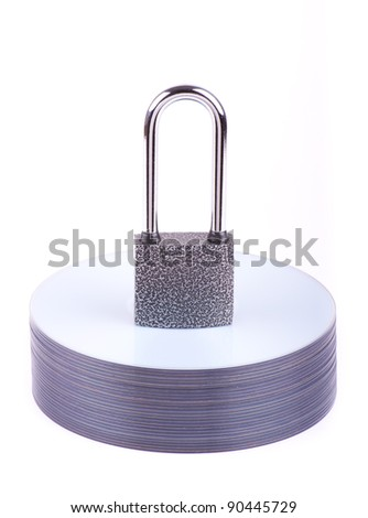 Padlock on the stack of CD isolated - stock photo