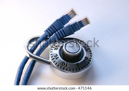 Padlock on two network cables - stock photo