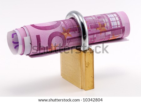 Padlock with banknote inside over white background - stock photo