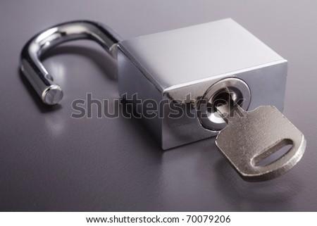 Padlock with key isolated on background. - stock photo