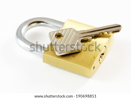 Padlock with key on it.Isolated on white background. - stock photo
