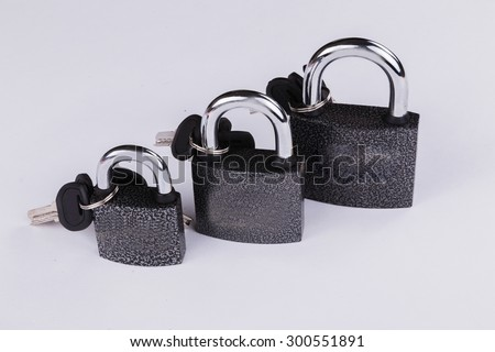 Padlock with keys. Door accessories. - stock photo