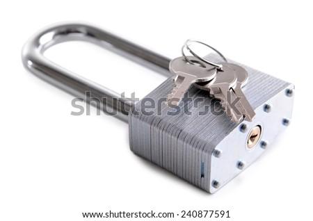 Padlock with keys isolated on white - stock photo