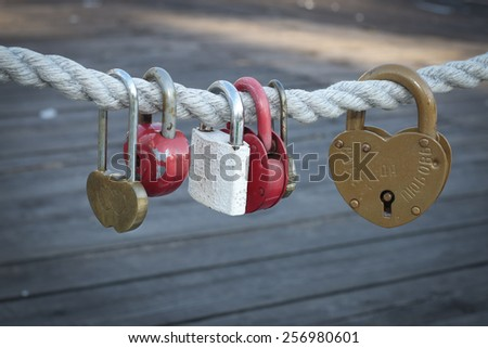 """Padlocks for love with words """"understanding and love!"""". Not brand - stock photo"""