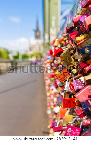 padlocks in cologne at the Hohenzollern Bridge - stock photo