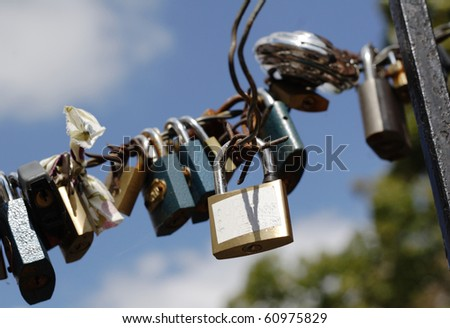 Padlocks on fence in Prague, symbol of love - stock photo
