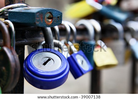 Padlocks on the rail (Romantic wedding tradition) - stock photo