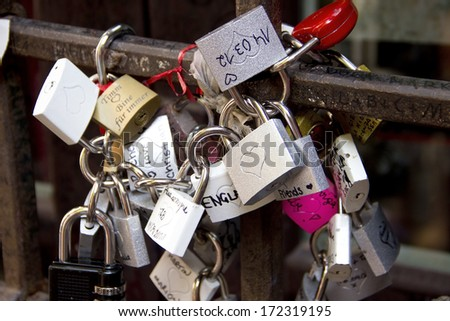 Padlocks, symbols of love in Julia's yard in Verona, Italy - stock photo
