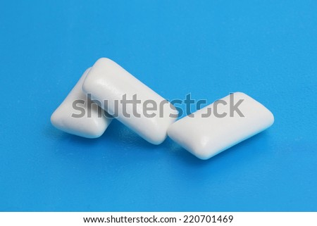 pads are chewing gum on blue background