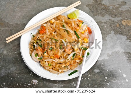 Padthai noodle on plastic dish with chopsticks and spoon