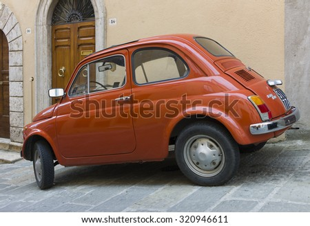 PADUA, ITALY - APRIL 20 2014 - An old red Fiat 500 parked in a street of the City of Padua, Italy - stock photo