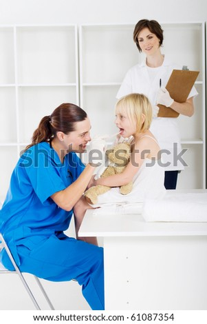 paediatrician checking little patient in office - stock photo