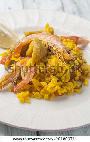 Paella rice with chicken and seafood typical Spanish