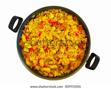 Paella with chicken in a pan - stock photo