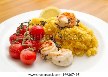 Paella with scrimps - stock photo