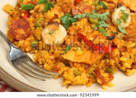 Paella with shrimps, chicken and chorizo. - stock photo