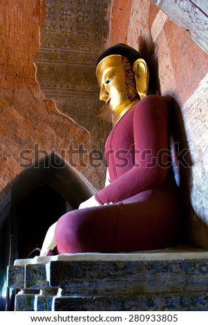 PAGAN, MYANMAR - JANUARY 7: Buddha statue inside ancient pagoda on January 7, 2011 in Bagan Kingdom, Myanmar. Bagan's prosperous economy built over 10000 temples between the 11th and 13th centuries. - stock photo