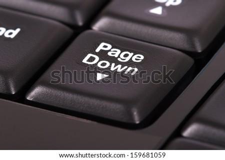 Page down key on black keyboard. - stock photo