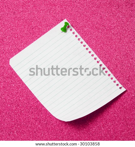 Page from note pad pinned to pinboard. - stock photo