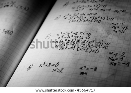 page of maths notebook- dramatic lightening - stock photo