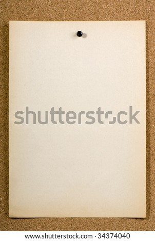 Page of old run-down paper attached to the bulletin board - stock photo