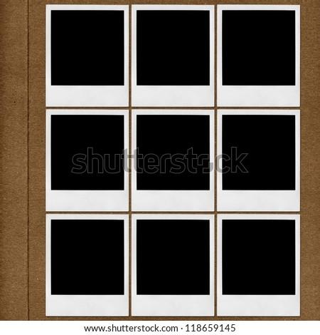 Page of photo album with Polaroid photo frames - stock photo