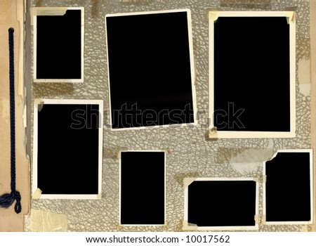 Page of vintage photo album, with blacked out photo frames.  This album dates from the 1940's. - stock photo
