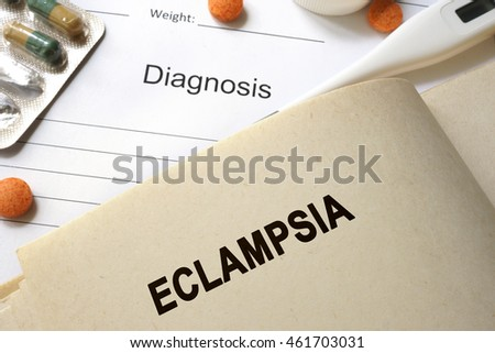 Page with word eclampsia and glasses. Medical concept.