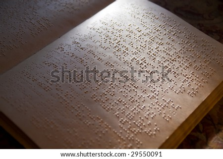 page written in braille alphabet for blind people - stock photo