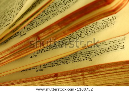 Pages being turned of a bible. - stock photo