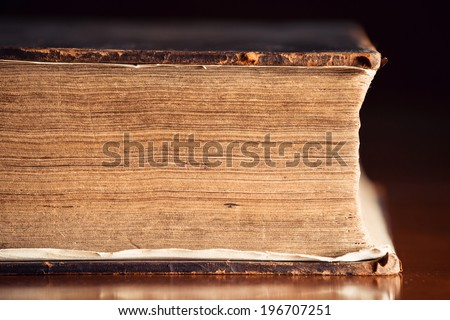 Pages Close Up of a very old Holy Bible  - stock photo
