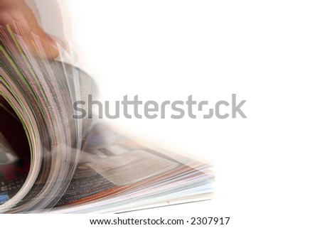 Pages of a book in motion.isolated on white - stock photo