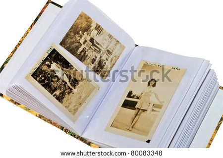 Pages of a photo album containing pictures from the year 1943, showing some summer scenes depicting the lifestyle. - stock photo