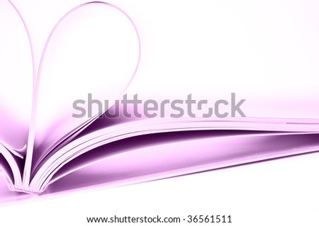 Pages of magazine curved into a heart shape - stock photo