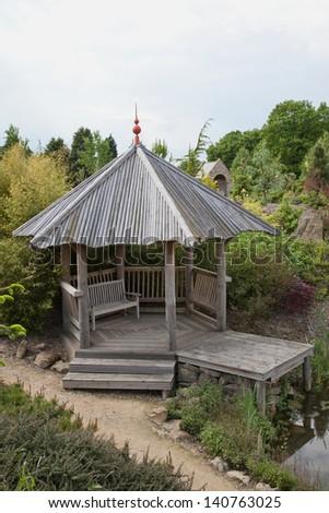 Pagoda by a pond - stock photo