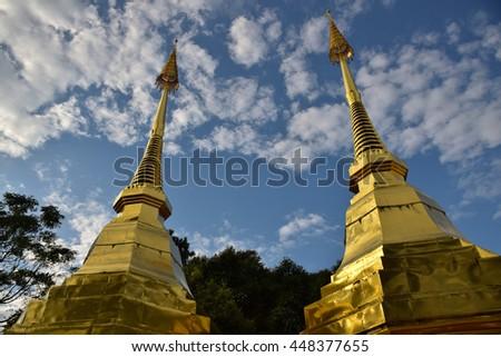 Pagoda in temple, Doi Tung,  Chiang Rai, northern of Thailand,blue sky, blue sky cloud,  - stock photo