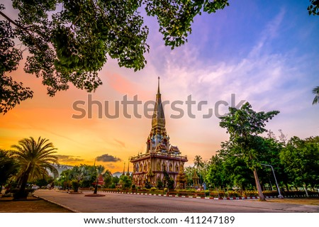 Pagoda in wat chalong or chalong temple with twilight background after sunset, public place.