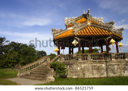Pagoda inside the purple forbidden city in Hue in Central Vietnam South East Asia - stock photo