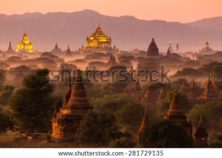 Pagoda landscape under a warm sunset in the plain of Bagan, Myanmar (Burma) - stock photo
