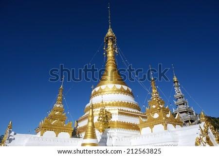Pagoda of Wat Chong Klang against a blue sky, Mae Hong Son, Thailand - stock photo