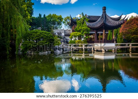 Pagoda reflecting in a pond at the Lan Su Chinese Garden, in Portland, Oregon. - stock photo