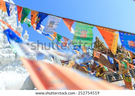 Pagoda with flag at Wat Sangkaew Potiyan temple in Chiang Rai, Thailand