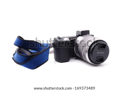 PAHANG, MALAYSIA-Dec 27, 2013: Photo of a compact camera, Sony Alpha NEX-5 with strap, isolated on white