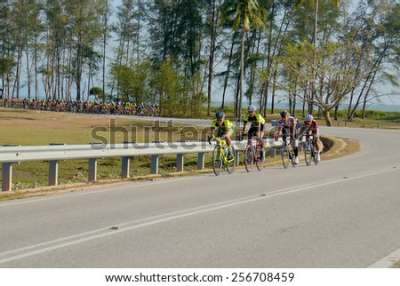 PAHANG, MALAYSIA-FEB 28: An unidentified group of cyclists in action at the final stage of UMP RIDE Challenge  on February 28, 2015 in Pahang. 280 cyclists took part in this open event. - stock photo