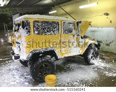 Pahang, Malaysia - 14 Nov 2016 . Old Yellow  four wheel drive in car wash. Antique land cruiser Fj40 / Bj40 model in car wash.