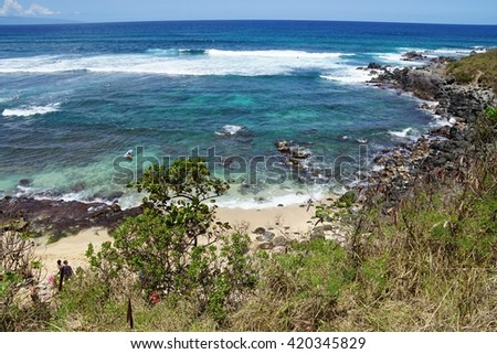 PAIA, HI -30 MARCH 2016- Hookipa Beach Park, on the North Shore of Maui, is world renowned for its windsurfing. It is also a popular nesting spot for Honu giant Hawaiian green sea turtles.