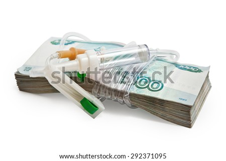 Paid medicine. A pack of Russian money tied system-the drip chamber for infusion. - stock photo